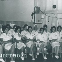 Image of Dorothy Aeschliman instructs Ecuadorian nurses on Voyage III Ecuador.