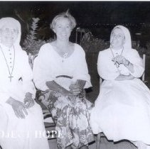 Image of Margaret Nyssen (center) Project HOPE OR nurse.
