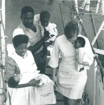 Image of Nurse with counterpart and family on gangway in Jamaica Voyage IX.