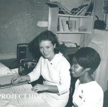 Image of Maxine Wilson-Young, EKG/EEG tech, with counterpart in Jamaica Voyage IX.