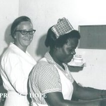 Image of Joan Karkeck, Dietitian, with counterpart in Jamaica Voyage IX.