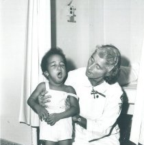 Image of Mandragos, Sister Theophane with patient in Jamaica Voyage IX.