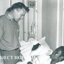 Image of Roger Purdy, chaplain, with patient on SS HOPE in Jamaica Voyage IX.