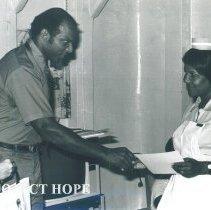 Image of Stephan McGruder Assist Adminstrator with Eleavor Peck far rt. Jamaica IX.