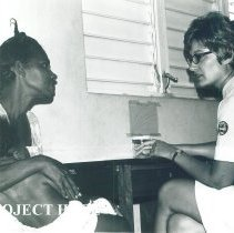 Image of Nurse Cynthia Holly with patient at Raetown Clinic in Jamaica Voyage IX.