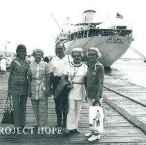 Image of Mrs Campbell with others on the dock in Jamaica Voyage XI.