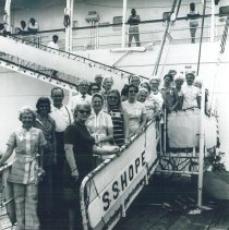Image of Group on gangway with Mrs Campbell in Jamaica Voyage IX.