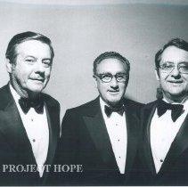 Image of Dr. Walsh, Dr. Henry Kissinger, and ?