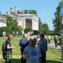 Image of Alumni boarding the bus in front of Carter Hall at the 2008 reunion in DC.