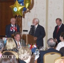 Image of Dr Howe and unknowns at the 2008 HOPE reunion in DC.