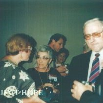 Image of unknowns and Tom Kirby at the 1993 reunion in Albuquerque.