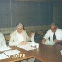 Image of Alumni board meeting with Eldon Ellis, John MacGregor and Herbert Bloom.