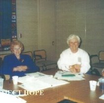 Image of Alice Mild and Alice Royaltey at an Alumni Board meeting at HOPE Center.