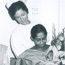 Image of Anne Fangman with first child born aboard the HOPE while in Ceylon.