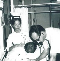 Image of Robert Kradjian and Christine Kradjian with patient on SS HOPE in Ceylon.