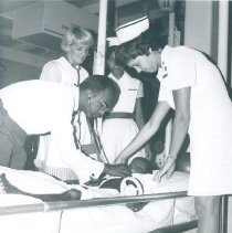 Image of Dr Vendanayke and Carol Rymer with Pediatric patient on SS HOPE in Ceylon.