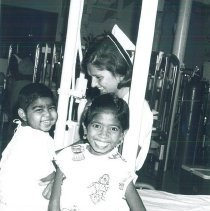 Image of Sylvia Lawrence plays with young patients on SS HOPE in Ceylon.