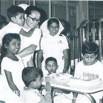 Image of Esther Pierce Kooiman helps a Pediatric patient celebrate a birthday.