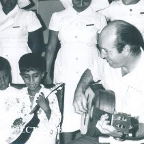 Image of Charlie Byrd entertains pediatric patients on SS HOPE in Ceylon.