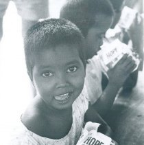 Image of Pediatric patients drinking milk from the SS HOPE in Ceylon.