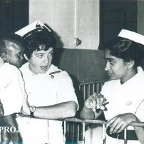 Image of Maureen Gallagher Dever with counterpart and patient on SS HOPE Ceylon.