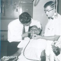 Image of Harry Kavanaugh with counterpart and patient in the Dental Clinic in Ceylon