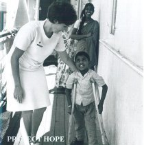 Image of Unknown nurse with patient on the SS HOPE in Ceylon.