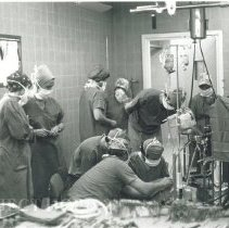 Image of American technicians from HOPE demonstrate a heart-lung machine.