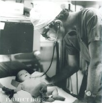 Image of Dr. Graham examines a baby at Institute of Pediatrics.