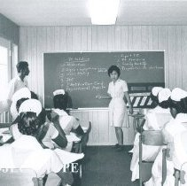 Image of Sato Hashizume with her counterpart giving a class on the SS HOPE in Ceylon