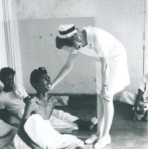 Image of Barbara Farley with patient at Kandy General Hospital in Ceylon.