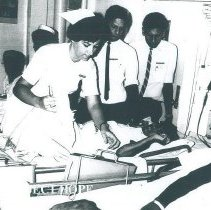Image of Renata Ropper with Ceylonese doctors on the SS HOPE in Ceylon.