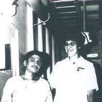 Image of Annette Bisanz with patient on the SS HOPE in Ceylon.