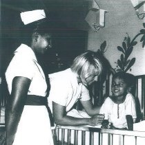 Image of Carol Rymer with counterpart on the SS HOPE in Ceylon.