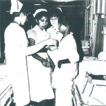 Image of Doreen Essenmacher, Annette Bisanz and counterpart on the SS HOPE in Ceylon