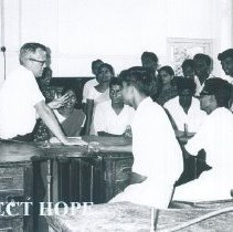 Image of Fred Miller with dental students at Kandy General Hospital in Ceylon.