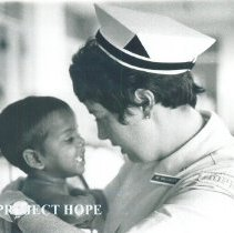 Image of Maureen Gallagher Dever with patient on the SS HOPE in Ceylon.