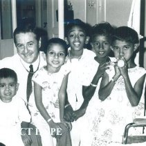 Image of William B Walsh with Pediatric patients on the SS HOPE in Ceylon.