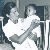 Image of Lilly Mallard with Pediatric patient on the SS HOPE in Ceylon.
