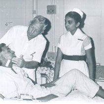 Image of William McCafferty with Ceylonese nurse and patienton the SS HOPE in Ceylon