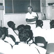 Image of Everett McClintock giving lecture to med student while in Ceylon.