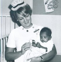 Image of Susan Papegaay with Pediatric patient on the SS HOPE in Ceylon.