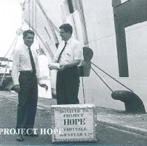 Image of William Peters accepts a donation of tea while the SS HOPE was in port Ceyl