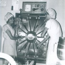 Image of Autoclave donated by American Sterilizer with Jeanette Dillman in Ceylon.