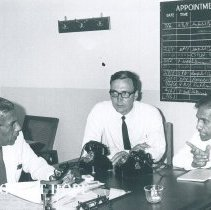 Image of l-r AKM Perera, James Howell and HC Uragoda on the SS HOPE in Ceylon.