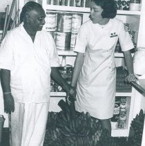 Image of Elizabeth Brannon presented with gift of bananas and green beans on SSHOPE.
