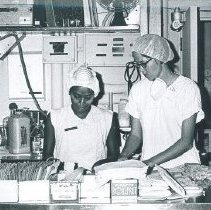 Image of Jeanette Dillman and counterpart on the SS HOPE in Ceylon.