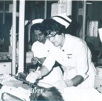 Image of Annette Bisanz with counterpart and patient on the SS HOPE in Ceylon.