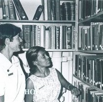 Image of Harriet Weller assists a nurse in the library on the SS HOPE in Ceylon.
