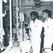 Image of Hugh Tatlock with medical students on the SS HOPE in Ceylon.
